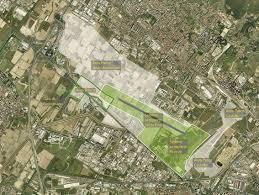 Ampliare un aeroporto: l'impatto sull'assetto socio-economico e sull'uso del suolo delle aree limitrofe